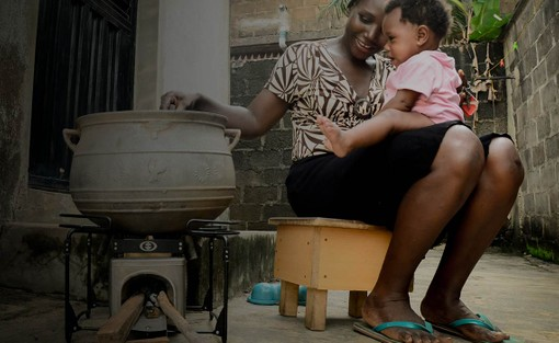 Image featuring a mother and child with an envirofit stove