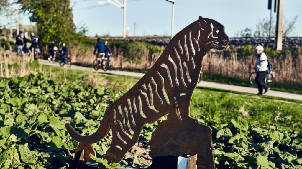 A leopard stands watch over the bike path. At night the creature shines with colorful LEDs. Photo credit Sune Schõning